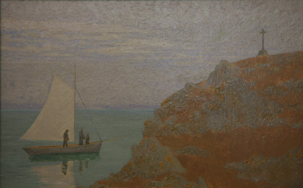 figures on a sailboat in prayer near a cross on a bluff